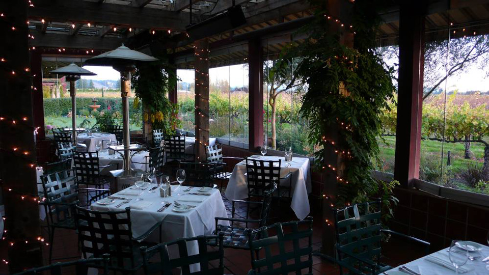 Festive Seating in the Enclosed Patio with a Vineyard View at John Ash & Co.