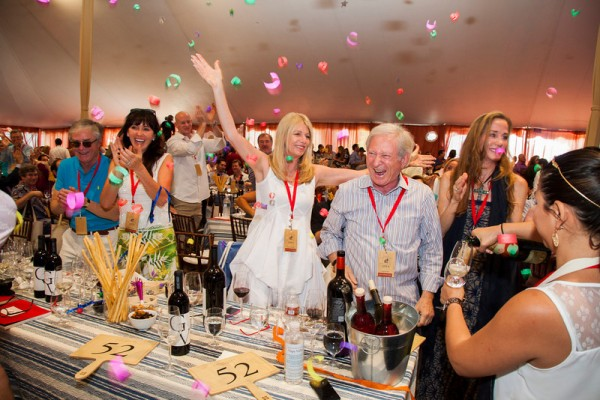 Celebrating the winning bid of lot number 1 at Auciton Napa Valley 2014. Photo by Jason Tinacci for the Napa Valley Vintners.